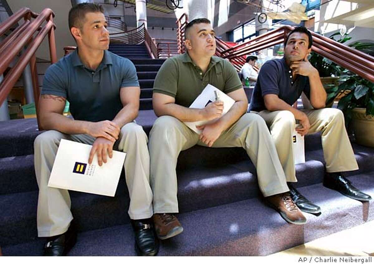 Military veterans Alex Nicholson, center, Jarrod Chlapowski, left, and Antonio Agnone, right, speak to a reporter during an interview, Tuesday, June 12, 2007, in Des Moines, Iowa. The three veterans are part of the Human Rights Campaign's