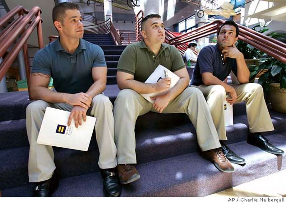 "Military veterans Alex Nicholson, center, Jarrod Chlapowski, left, and Antonio Agnone, right, speak to a reporter during an interview, Tuesday, June 12, 2007, in Des Moines, Iowa. The three veterans are part of the Human Rights Campaign's ""Legacy of Service National Tour"" that kicks off its campaign in Des Moines. The tour's goal is to put pressure on politicians to repeal Don't Ask, Don't Tell, a policy detractors say is out-dated and costing the military valuable gay and lesbian enlistees. (AP Photo/Charlie Neibergall) Photo: Charlie Neibergall"