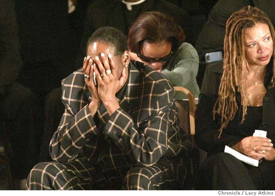 Snoop Dogg covers his eyes and cries for his friend friend Stanley Tookie Williams after paying tribute to him at his funeral in Los Angeles, Dec. 20, 2005.Behind him is his wife and to the right is kasi Lemmons.  Funeral for Stanley Tookie Williams at the Bethel Church in Los Angeles, Dec. 20, 2005 Photo By Lacy Atkins Photo: LACY ATKINS