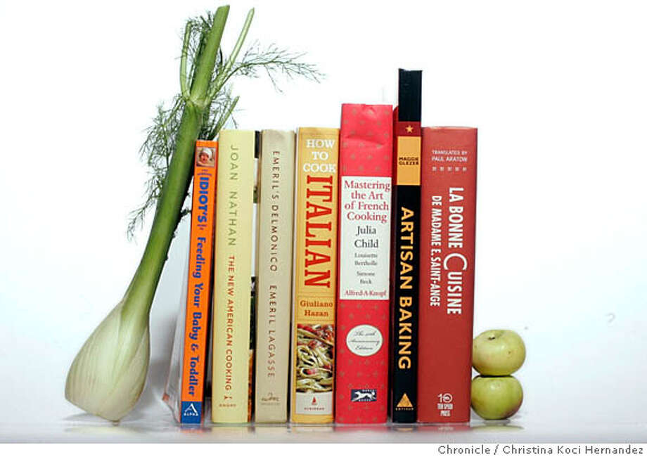 CHRISTINA KOCI HERNANDEZ/CHRONICLE  Story Description: Please shoot cookbooks individually (against a white background, to be cut out) and stacked together. There are 7 of them, stacked on Miriam's desk in Food newsroom. Photo: CHRISTINA KOCI HERNANDEZ