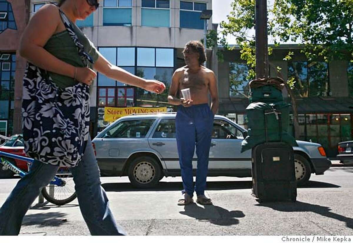 """berkeley14000122.JPG Homeless man Michael Etheridge panhandles on Telegraph Avenue in Berkeley and he may be breaking the law based on the new Public Commons"""" measure in Berkeley. - Berkeley City Council approved the measure Tuesday as part of a crackdown on aggressive and disruptive street behavior on Berkeley Streets. Mike Kepka / The Chronicle Michael Etheridge (cq) MANDATORY CREDIT FOR PHOTOG AND SF CHRONICLE/NO SALES-MAGS OUT"""