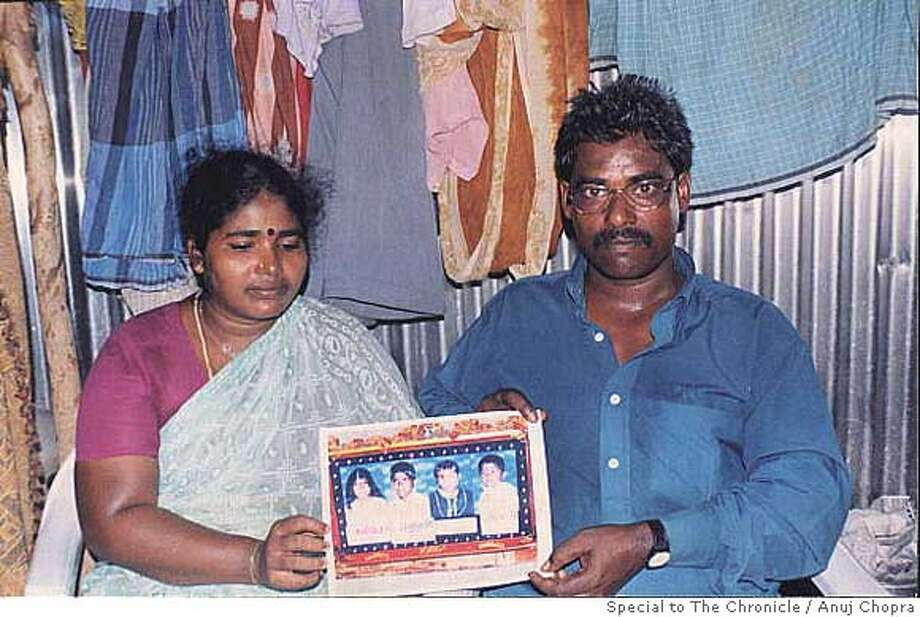 Lakshmi (left) and her husband, Selvamani hold out a picture of their four children who were devoured by the giant waves of the tsunami. Recanalisation didn't work for Lakshmi, so she resorted to IVF. Even that eventually failed her, aggravating their desperation for children. Photo by Anuj Chopra/Special to The Chronicle Ran on: 12-21-2005  Lakshmi (left) and her husband, Selvamani, hold a picture of their children, who all were swallowed by the sea during the tsunami. Photo: Anuj Chopra/Special To The Chron