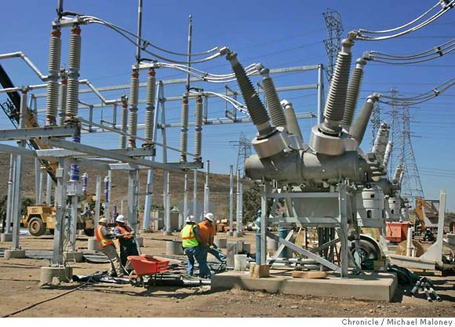 CALPINE_069_MJM.jpg  Construction workers work in the transformer yard. The Metcalf Energy Center (MEC) located just off of 101 in South San Jose is under construction and is Calpine's latest energy center. The California Energy Commission approved a license for the Metcalf Energy Center in September of last year, after nearly two and one-half years of review. This natural gas-fired energy center when on line in the summer of 2005, will provide a vital source of electricity for San Jose. Using a process called cogeneration - producing power and steam from a single fuel source - the MEC will increase energy efficiency and lower emissions. The Metcalf plant will generate electricity using natural gas-fired turbines and recover the hot combustion exhaust to create steam, which will generate additional electricity with steam turbine  Photo by Michael Maloney / San Francisco Chronicle Ran on: 09-05-2004 Ran on: 09-05-2004 Ran on: 09-05-2004  The Metcalf Energy Center, off Highway 101 in South San Jose, was approved by the California Energy Commission in September last year, after a lengthy review. Ran on: 05-26-2005  Cartwright Ran on: 12-08-2005  The Metcalf Energy Center in south San Jose is part of Calpine's network of plants in California. MANDATORY CREDIT FOR PHOTOG AND SF CHRONICLE/ -MAGS OUT Photo: Michael Maloney
