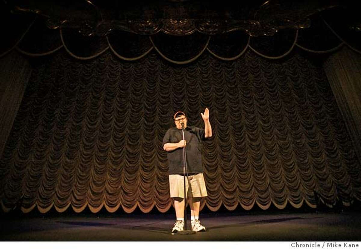 Michael Moore addresses the audience before a screening of his new documentary about U.S. health care, Sicko, at Crest Theater in Sacramento, CA, on Tuesday, June, 12, 2007. photo taken: 6/12/07 Mike Kane / The Chronicle *