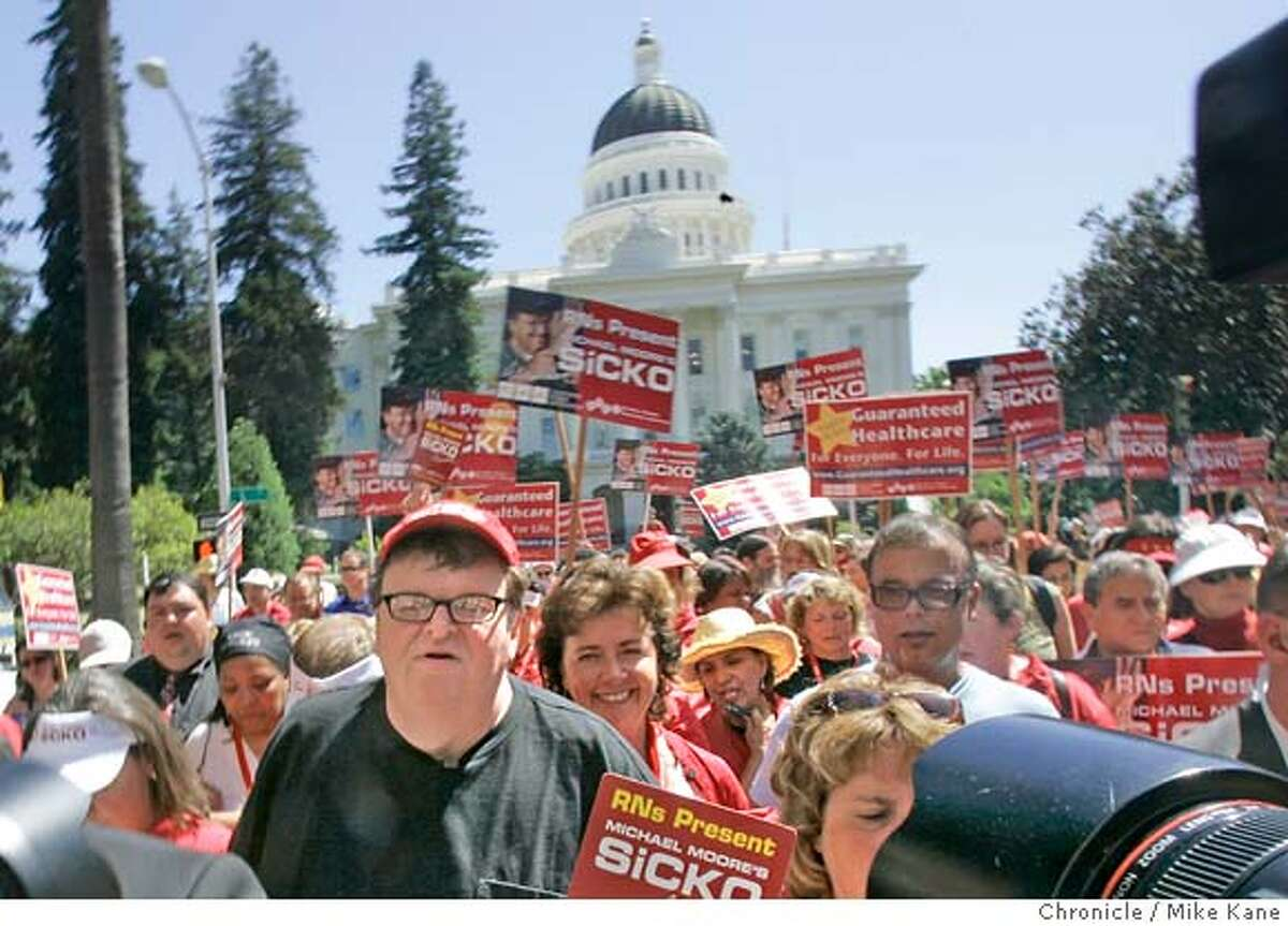 Registered nurses, doctors, patients and other supporters march with Michael Moore, left, to a screening of his new documentary Sick at the Capital in Sacramento, CA, on Tuesday, June, 12, 2007. photo taken: 6/12/07 Mike Kane / The Chronicle *