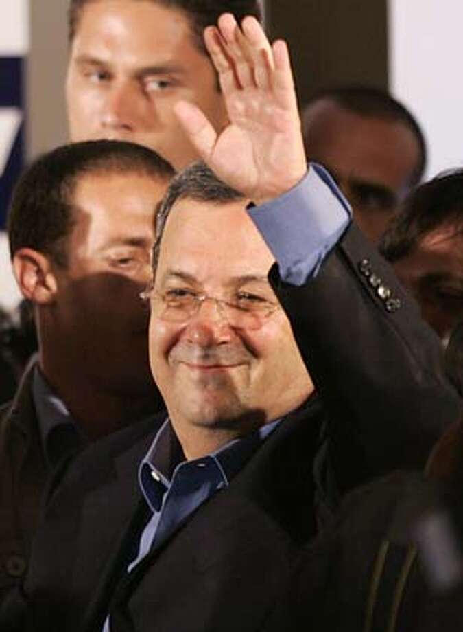 ** CORRECTS LAST NAME TO BARAK ** Former Israeli Prime Minister Ehud Barak waves to supporters as he arrives to make a victory speech for the party's leadership at the Labor Party headquarters in Tel Aviv, Israel, early Wednesday, June 13, 2007. The former Israeli prime minister won the Labor Party primary over a relative political newcomer, party officials from both camps said late Tuesday, in a race between two ex-military officers who both called on Prime Minister Ehud Olmert to step down. (AP Photo/Ariel Schalit) Photo: Ariel Schalit