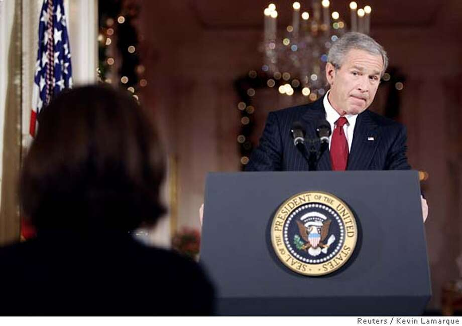 "U.S. President George W. Bush listens to a question during a press conference in the East Room of the White House in Washington, December 19, 2005. During today's press conference, Bush vowed to authorize more eavesdropping on Americans suspected of ties to terrorists and said he believed a probe was underway into who committed ""the shameful act"" of revealing the covert program. REUTERS/Kevin Lamarque 0 Photo: KEVIN LAMARQUE"
