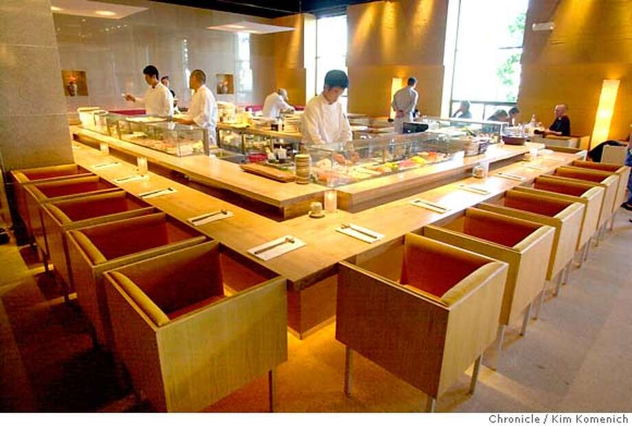 WHATSNEW30b-C-23MAY01-FD-KK  Ozumo, a sushi bar, robatqa grill and sake lounge which has been opened in the former Harry Denton's. This is your sushi bar.  CHRONICLE PHOTO BY KIM KOMENICH Ran on: 06-13-2007  The sleek bar is part of the stylish allure of Ozumo on Steuart Street in San Francisco. Photo: KIM KOMENICH