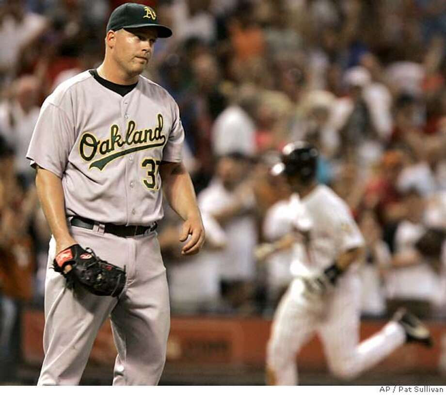 Oakland Athletics pitcher Joe Kennedy (37) reacts to a two-run home run by Houston Astros' Brad Ausmus, right, in the fourth inning in a baseball game Tuesday, June 12, 2007 in Houston. (AP Photo/Pat Sullivan) Photo: Pat Sullivan