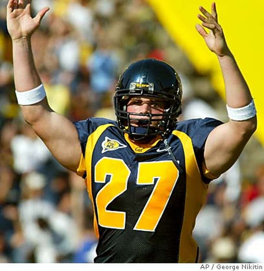 California's Chris Manderino celebrates after the first California touchdown in the first quarter against Southern California, Saturday Sept. 27, 2003, at Memorial Stadium in Berkeley, Calif. Clifornia beat Southern California, 34-31. (AP Photo/George Nikitin) Ran on: 11-16-2005  Chris Manderino could add two 1,000-yard rushers this season to the list of Bears for whom he's helped clear paths at Cal. Ran on: 11-16-2005  Chris Manderino could add two 1,000-yard rushers this season to the list of Bears for whom he's helped clear paths at Cal. CAT Photo: GEORGE NIKITIN
