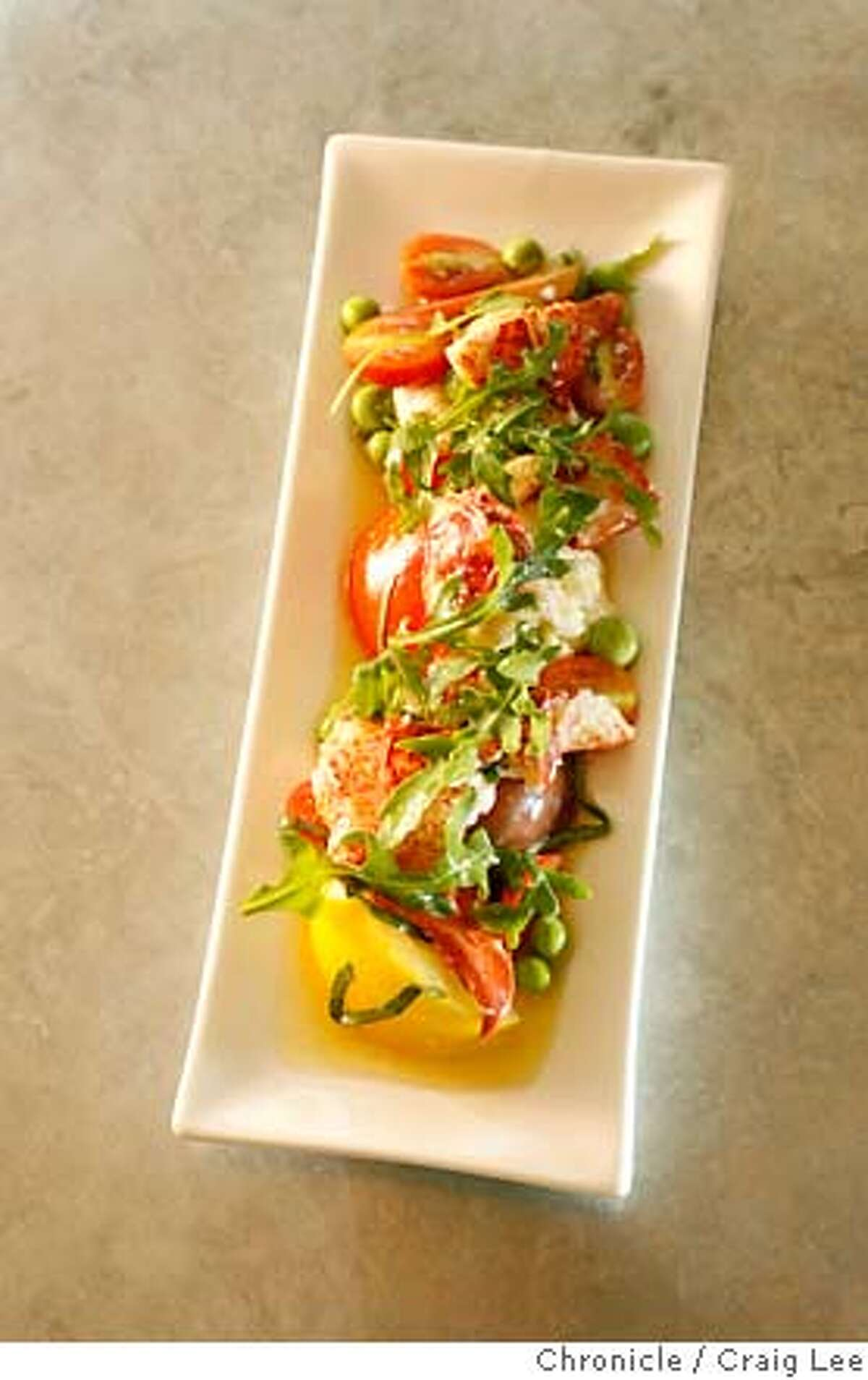 SALAD13_050_cl.JPG Photo of Maine Lobster Salad at Bar Crudo restaurant, 603 Bush Street in San Francisco. Maine Lobster Salad with English Peas, Heirloom Tomatoes, Burrata Cheese, Banyuis Vinaigrette and Wild Arugula. Event on 6/4/07 in San Francisco. photo by Craig Lee / The Chronicle MANDATORY CREDIT FOR PHOTOG AND SF CHRONICLE/NO SALES-MAGS OUT