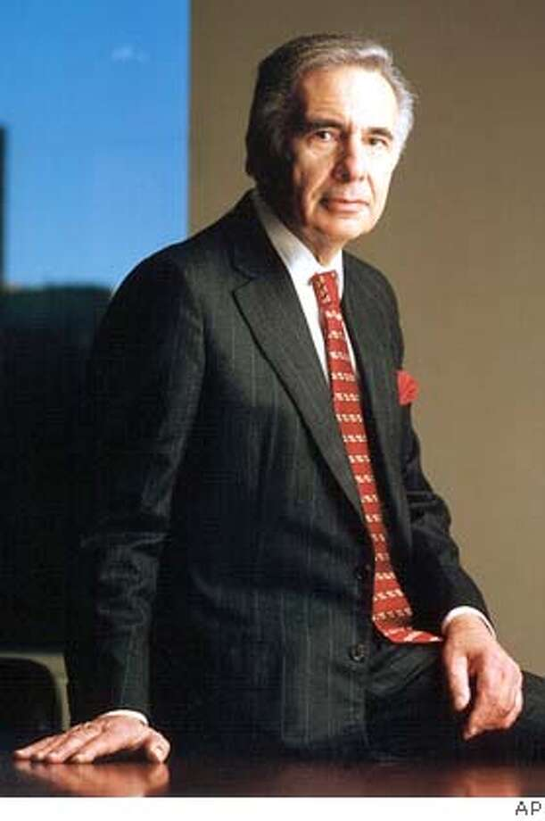 ** FILE ** Financier Carl Icahn, is shown in this undated 2001 handout photo. Icahn disclosed Monday, Aug. 15, 2005, that he and a group of investors will press Time Warner Inc. to shed its cable TV unit and embark on an aggressive buyback of $20 billion of its own shares. Icahn, who is known for taking stakes in companies and agitating for strategic changes, said he and three other investors have amassed more than 120 million shares of Time Warner, or about 2.6 percent of the giant media conglomerate, which owns CNN, HBO, Warner Bros. and the country's second-largest cable TV provider. (AP Photo/file) Ran on: 08-16-2005  Icahn Ran on: 12-03-2005  Chinese river tested after toxic spill. UNDATED HANDOUT PHOTO, Photo: AP