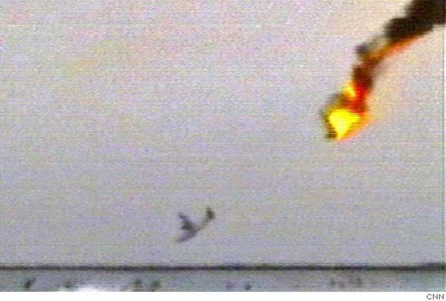 In this amateur video image taken from CNN television, a propeller-driven seaplane carrying 20 people crashes just off Miami Beach within sight of the city's high-rises Monday Dec. 19, 2005. The crash killed at least 19 of those aboard, authorities said. (AP Photo/Amateur Video, CNN Exclusive)