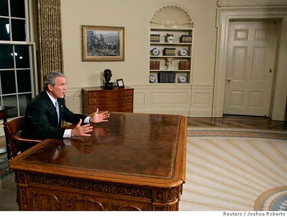 """U.S. President George W. Bush is photographed shortly after delivering a speech about U.S. involvement in Iraq from the Oval Office in the White House in Washington December 18, 2005. Bush made an unusually direct personal appeal to Americans on Sunday night not to give in to despair over Iraq, insisting """"We are winning"""" despite a tougher-than-expected war. REUTERS/Joshua Roberts 0 Photo: JOSHUA ROBERTS"""
