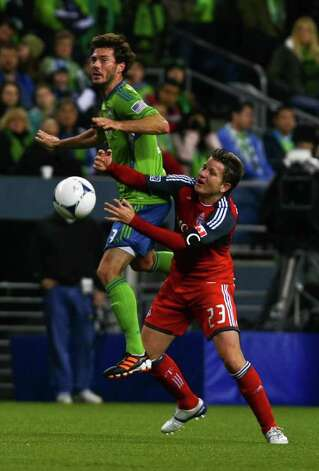 Brad Evans of the Seattle Sounders goes for a header against Terry Dunfield of the Toronto FC at CenturyLink Field in Seattle on Saturday, March 17, 2012. Photo: JOE DYER / SEATTLEPI.COM