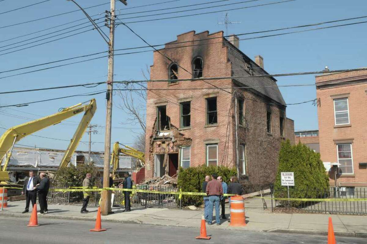 A view of a structure at 605 Union Street, on the left, that sustained fire damage, seen here on Sunday, March 18, 2012 in Schenectady, NY. The fire was called in at 5:20 a.m. Saturday and gutted the inside of the building. No one was inside at the time of the blaze, said Schenectady Deputy Fire Chief Raymond Senecal. The cause of the fire is still under investigation. (Paul Buckowski / Times Union)