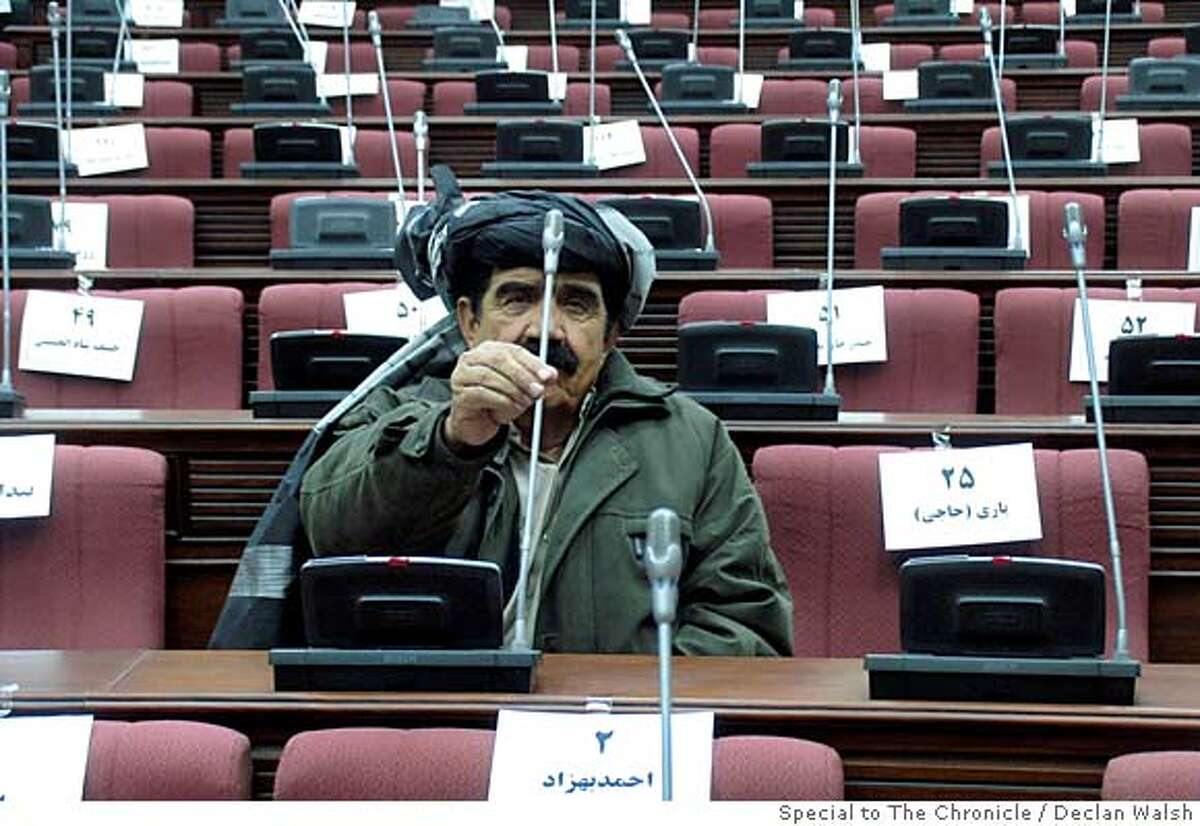 Pasha Khan Zadran, a tribal leader and now MP for Khost province, at his seat in the new Afghan Wolesi Jirga, or lower house of parliament, during an orientation session before the Dec 19 opening. By Declan Walsh