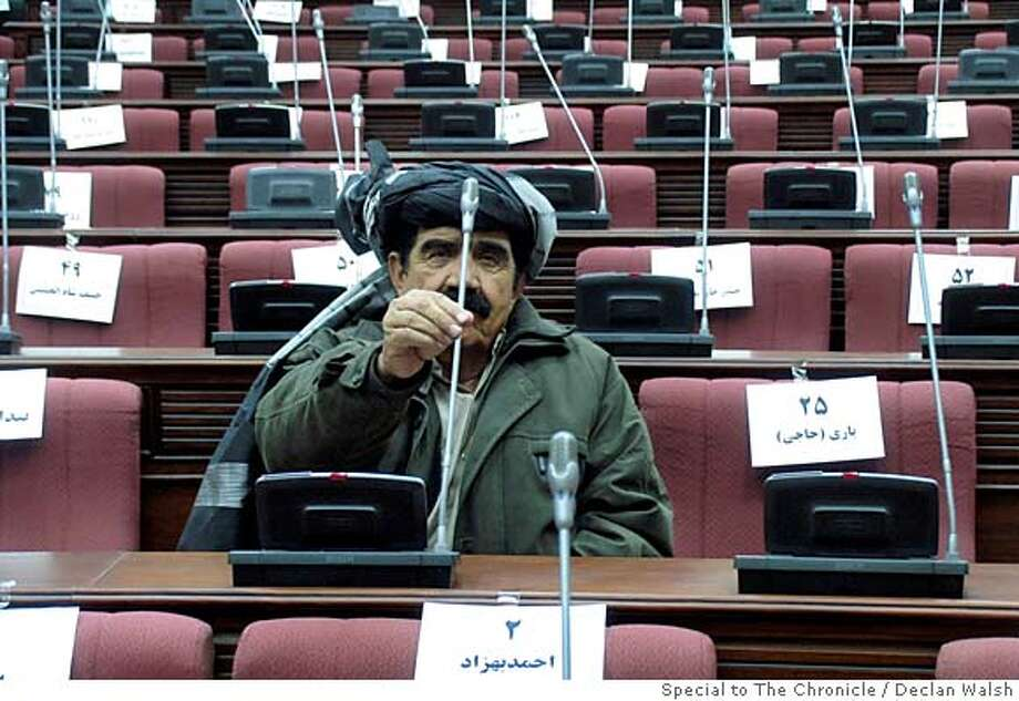 Pasha Khan Zadran, a tribal leader and now MP for Khost province, at his seat in the new Afghan Wolesi Jirga, or lower house of parliament, during an orientation session before the Dec 19 opening. By Declan Walsh Photo: Declan Walsh