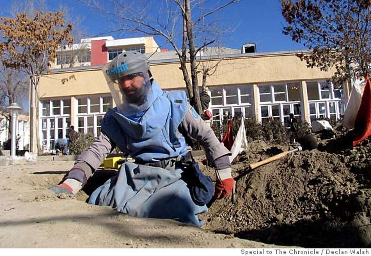Deminer at work in the grounds of the renovated Afghan parliament (background), days before the Dec 19 inauguration of the parliament. December 2005. By Declan Walsh