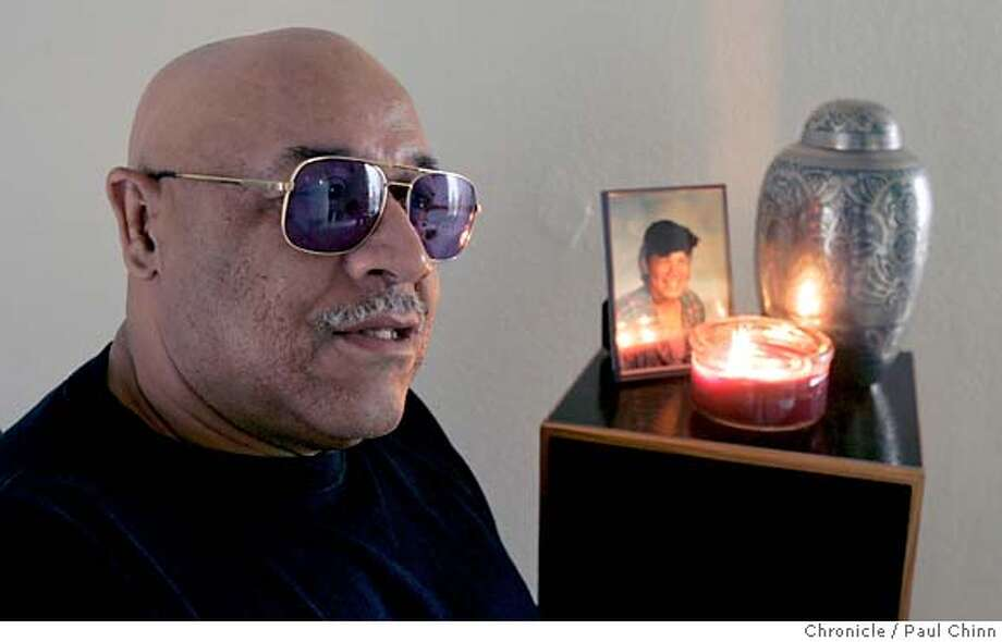 sos_davis_026_pc.jpg  For Season of Sharing: Louie Davis honors his daughter LaToya Davis every day by lighting a candle in her memory in his apartment in Fremont, Calif. on 12/13/05. PAUL CHINN/The Chronicle MANDATORY CREDIT FOR PHOTOG AND S.F. CHRONICLE/ - MAGS OUT Photo: PAUL CHINN