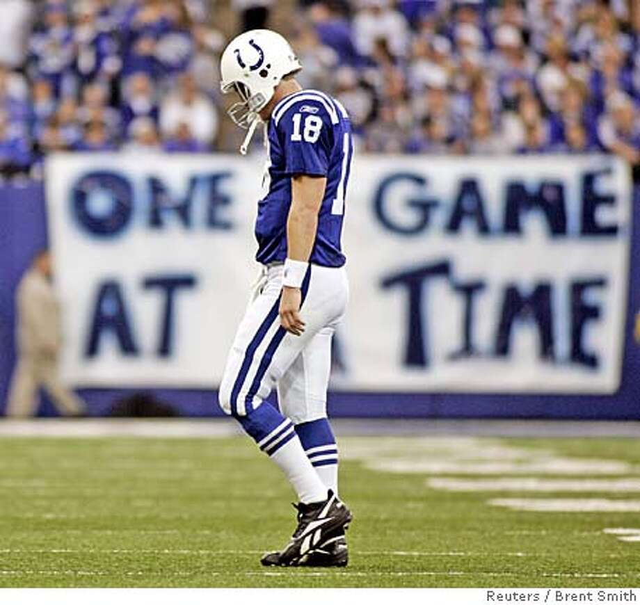 Indianapolis Colts quarterback Peyton Manning walks off the field in a game against the San Diego Chargers during the second quarter of NFL play at the RCA Dome in Indianapolis December 18, 2005. San Diego won the game 26-17 handing Indianapolis their first loss of the season. REUTERS/Brent Smith 0 Photo: BRENT SMITH