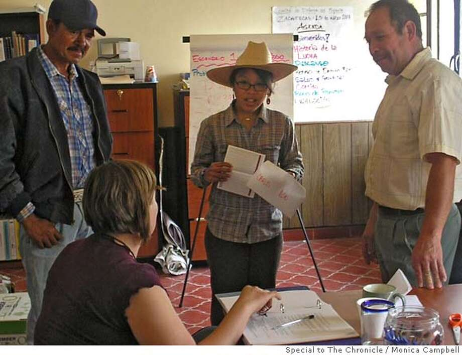 At the Center for Migrant Rights' office in Zacatecas, Mexico, Mexican outreach workers and the non-profits staff role play a scenario in which an employer has under paid immigrants workers in the United States. Paralegal and Center for Migrant Rights employee Jess Fry is seated. On th left is outreach worker Armando Avila, center is Center for Migrant Rights intern Cheryl Andrade, and to the left is outreach worker Francisco Fernandez. Monica Campbell/Special to The Chronicle. Photo: Monica Campbell