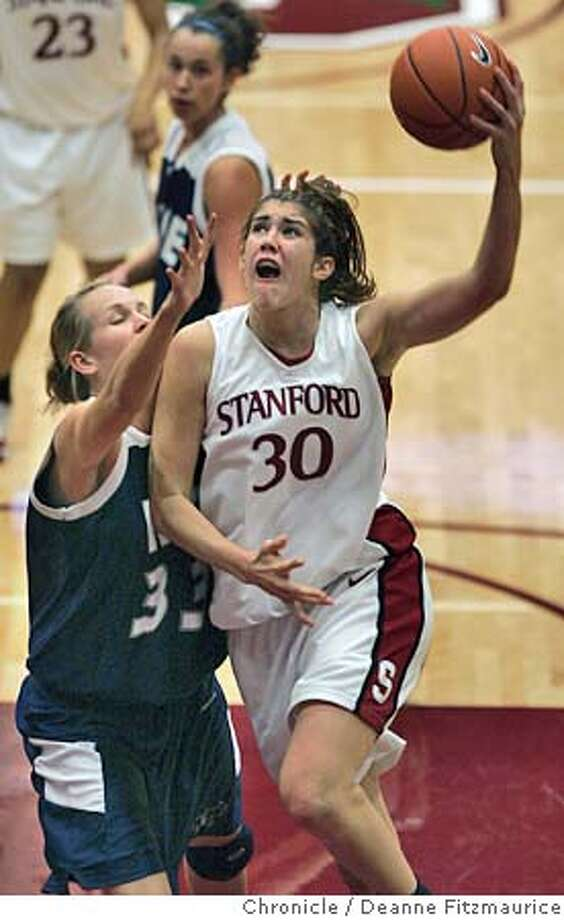 Brooke Smith goes up to the basket against defender Catherine Dupont as Stanford Cardinal beats Rice at Maples Pavilion.  Event in Stanford on 12/17/05.  Deanne Fitzmaurice / The Chronicle Photo: Deanne Fitzmaurice