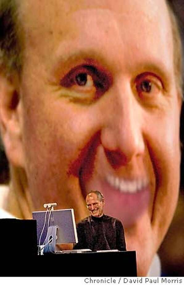SAN FRANCISCO - JUNE 11: Apple CEO Steve Jobs laughs at an image of Microsoft CEO Steve Ballmer as he delivers the keynote speech at the Apple Web Developers conference at the Moscone Center on June 11, 2007 in San Francisco, California. During his keynote, Jobs demonstrated new features in the Leopard operating system that will be released in October.(Photo by David Paul Morris/The Chronicle) Photo: David Paul Morris