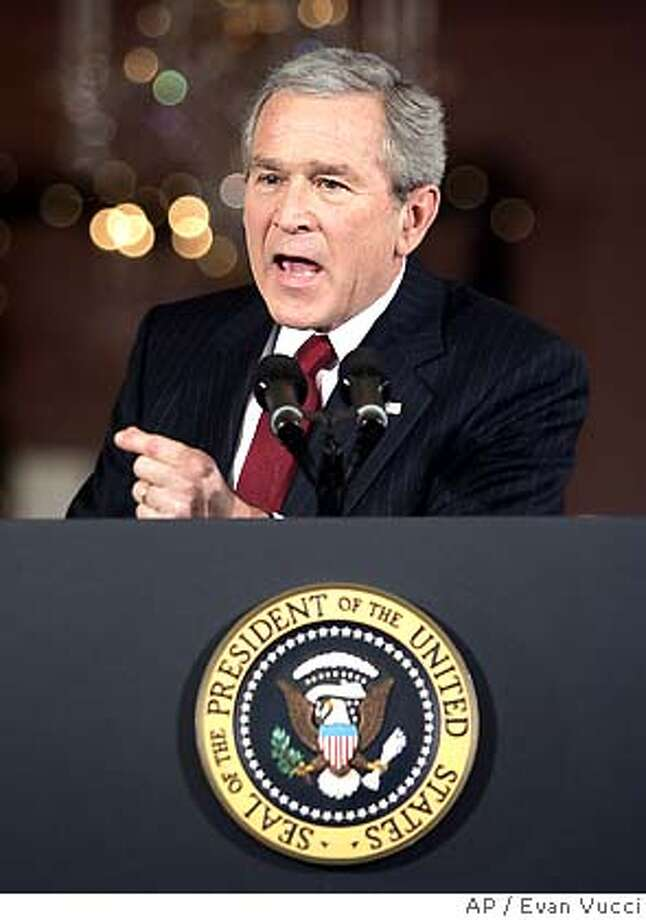 "President Bush gestures during a news conference in the East Room of the White House on Monday, Dec. 19, 2005 in Washington. Bush, brushing aside bipartisan criticism in Congress, said Monday he approved spying on suspected terrorists without court orders because it was ""a necessary part of my job to protect"" Americans from attack. (AP Photo/Evan Vucci) Photo: EVAN VUCCI"