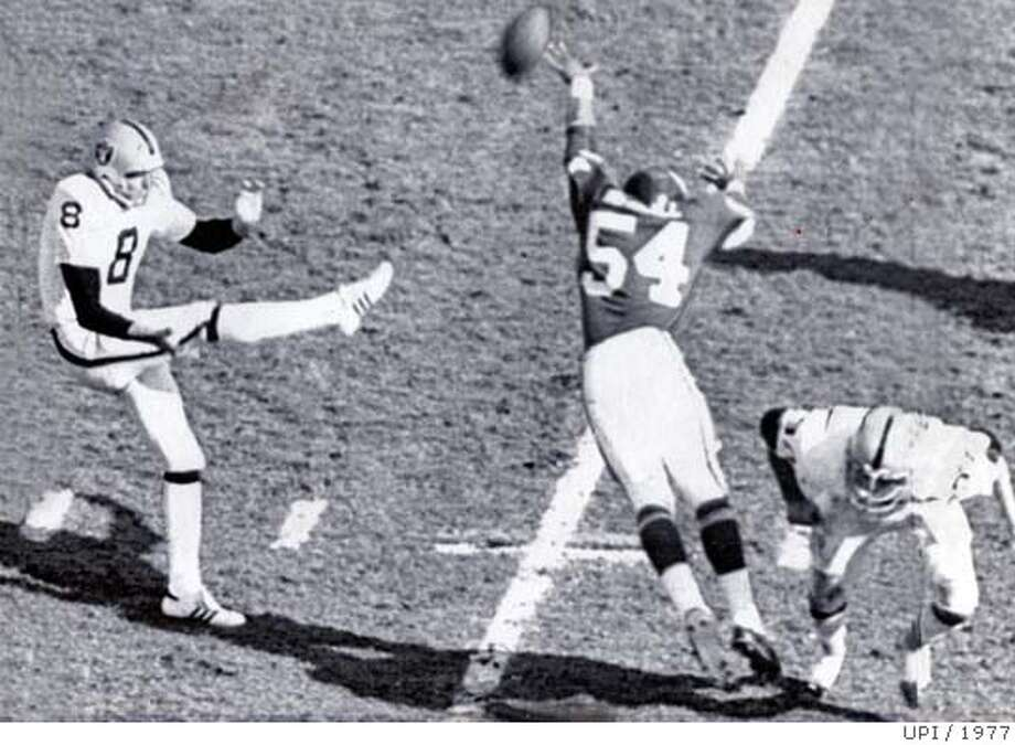 GUY-C-16DEC99-SP-UPI--Minnesota Viking linebacker Fred McNeill tips the ball to deflect this first period punt by Oakland Raider Ray Guy during Super Bowl XI in 1977. PHOTO CREDIT:UPI/1977 Photo: Adfadf