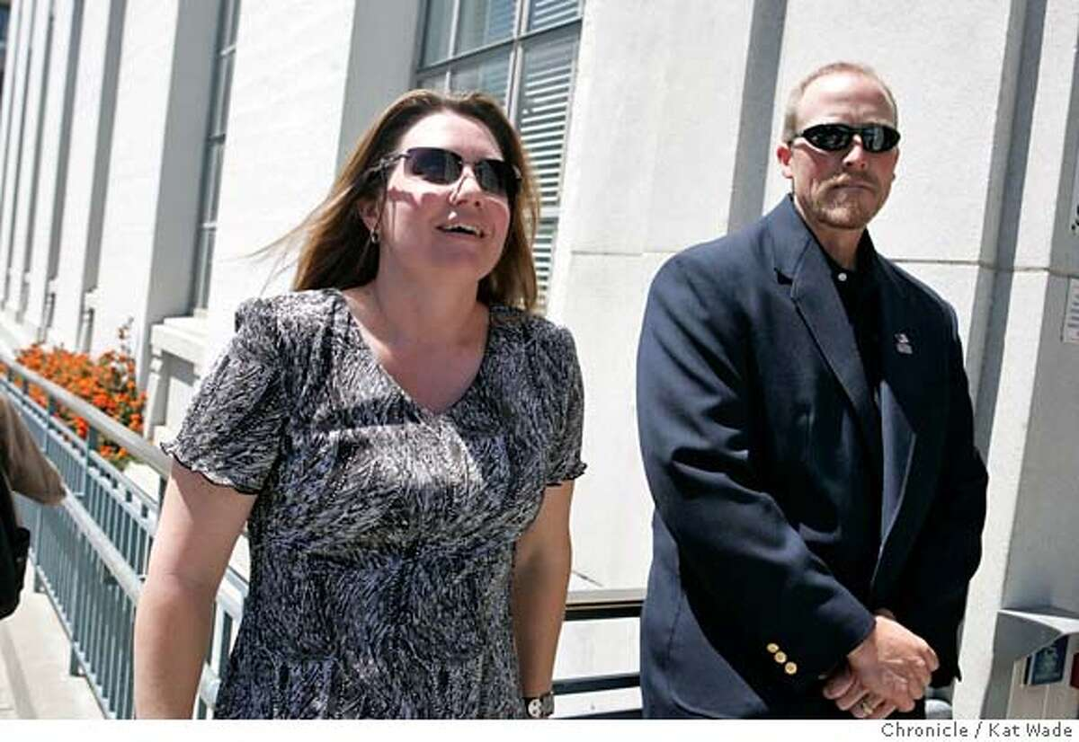 """COPSLAY12_0026_KW.JPG (L TO R) Officer Niemi's widow, Dionne Niemi talks to the press with Officer Greg Lemmon at her side outside the court house after Irving Ramirez was sentenced to death for the 2005 murder of her husband, San Leandro Police Officer Nels """"Dan"""" Niemi on Monday June 10, 2007 in Alameda County Superior Court in Oakland. Kat Wade/The Chronicle Dionne Niemi and Officer Greg Lemmon (CQ, subject) Mandatory Credit for San Francisco Chronicle and photographer, Kat Wade, No Sales Mags out"""