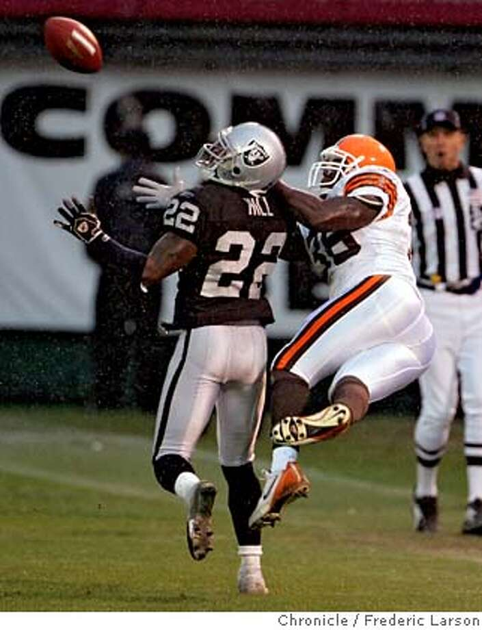 RAIDERS_964_fl.jpg Raiders Renaldo Hill makes a great pick over Browns FB Corey McIntyre in the fouth quarter. Oakland Raiders come up short to the Cleveland Browns on a last second field goal where the Browns edged the Raiders 9-7 at McAfee Coliseum in Oakland. 12/19/05 Oakland CA Frederic Larson San Francisco Chronicle Photo: Frederic Larson