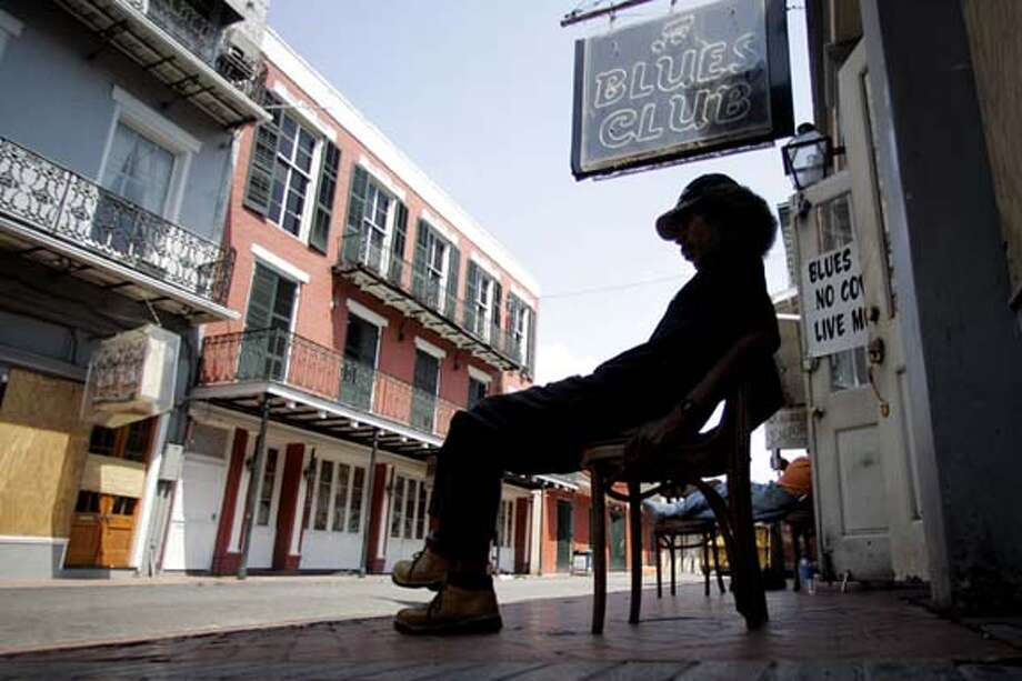 Ted Mack sits outside a bar on Bourbon Street in the historic French Quarter in New Orleans, La., Tuesday Sept. 6, 2005. Some bars are open in the French Quarter despite efforts by city and national authorities to completely evacuate the flood besieged city. (AP Photo/Rick Bowmer) Photo: RICK BOWMER