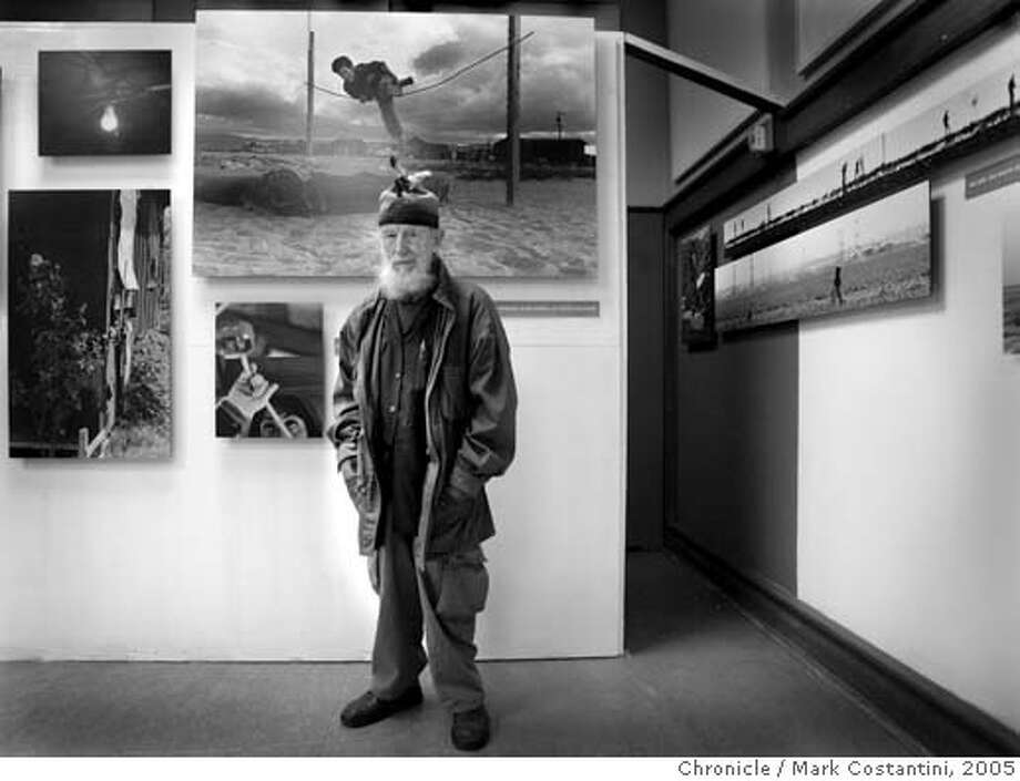 "In 1956, documentary photographer George Elfie Ballis, (pictured here) began a photographic essay including still photographs, film and video on the human condition of farm workers. The exhibit opened this week at UC Berkeley's Boalt School of Law. It's a large-scale work that includes 160 still photographs and 16 documentary films converted to video. Ballis, who studied under famous photographer Dorothea Lange in the late 1950's, is now 80 years old. The exhibit, ""Dream What We Can and Rejoice"" will run until May 1, 2006, ending 50 years after it started.  Event on 12/15/05 in Berkeley  Photo: Mark Costantini /San Francisco Chronicle. Photo: MARK COSTANTINI"