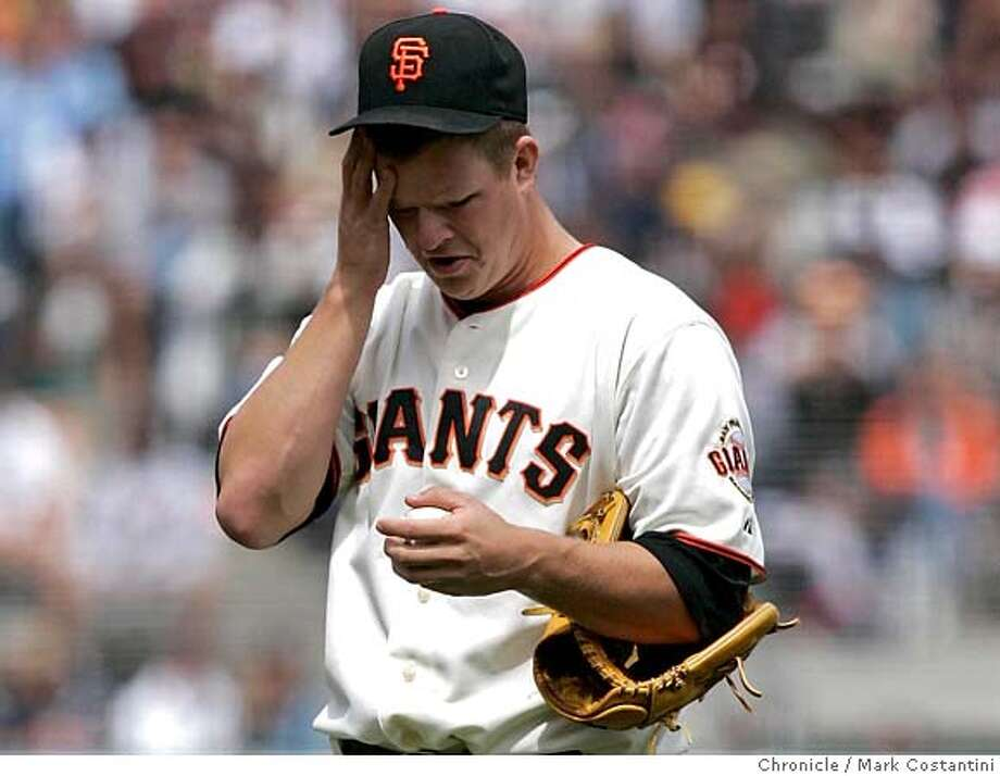 loing pitcher Matt Cain looks dejected after giving a home run to A's batter Marco Scutero in the 8th inning. lose to the A's in San Francisco. PHOTO: Mark Costantini / The Chronicle Photo: MARK COSTANTINI