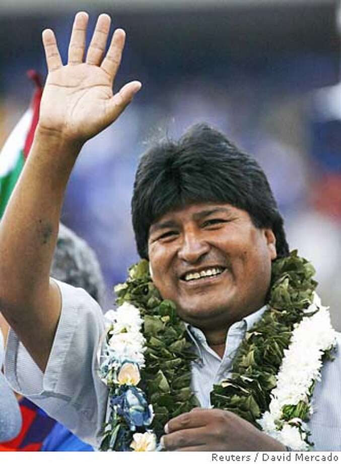 Bolivian presidential candidate Evo Morales of the Movement Toward Socialism (MAS) party waves to thousands of supporters during his final campaign rally in the city of Cochabamba, central Bolivia, December 15, 2005. The latest opinion polls show Morales leading his closest contender by five percentage points before the December 18 election. REUTERS/David Mercado Ran on: 12-18-2005  Jorge &quo;Tuto&quo; Quiroga, shown with a backer, is a U.S.-taught product of Bolivia's upper class. Photo: DAVID MERCADO