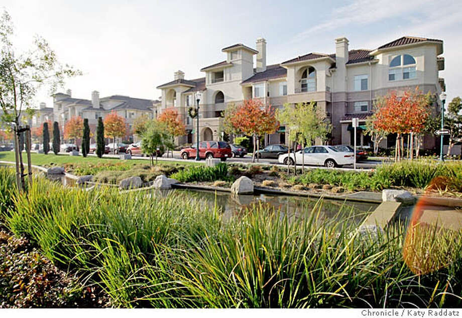 MODEL18_011_RAD.JPG New condos at the Bay Meadow site in San Mateo. SHOWN: The exterior of one of the buildings in the development showing the landscaping and the stream that separates the residences from the commercial area. Photo taken on 12/11/05, in San Mateo, CA.  By Katy Raddatz / The San Francisco Chronicle MANDATORY CREDIT FOR PHOTOG AND SF CHRONICLE/ -MAGS OUT Photo: Katy Raddatz