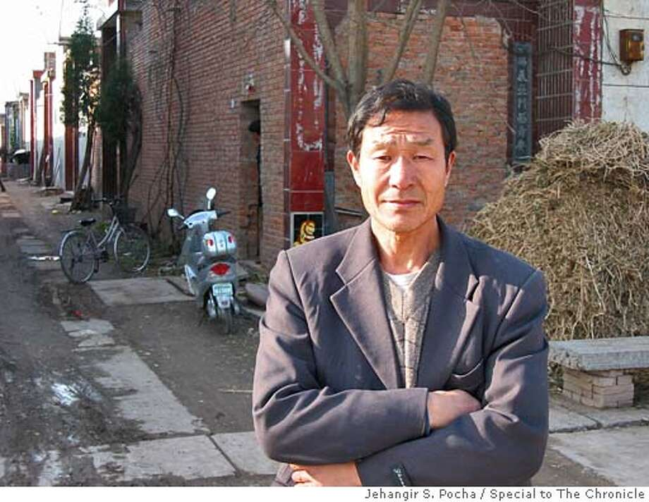 Photo Lu Yidao, village chief. Photo by Jehangir S. Pocha/Special to The Chronicle Photo: Jehangir S. Pocha/Special To The
