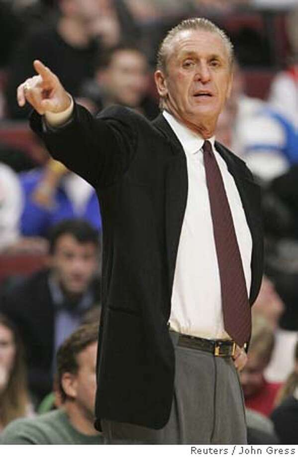 Miami Heat head coach Pat Riley calls out a play as his team plays the Chicago Bulls during the second half of their National Basketball League game in Chicago, December 13, 2005. Riley returned as coach of the Miami Heat on December 12 after Stan Van Gundy resigned for family reasons. REUTERS/John Gress 0 Photo: JOHN GRESS