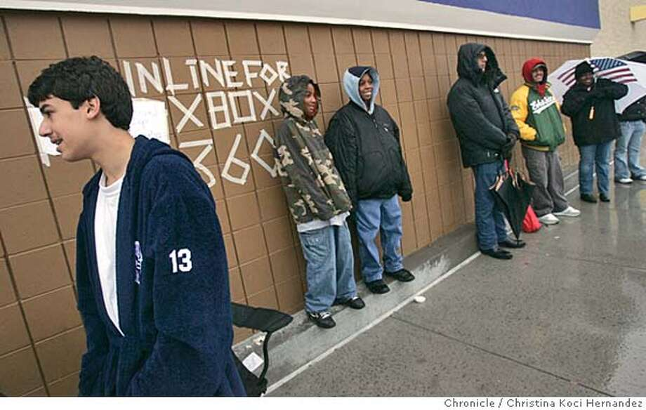 CHRISTINA KOCI HERNANDEZ/CHRONICLE  (L)Shaheen Axtle, 15, of Oakland waits in line with others to buy new XBOX Sunday morning at 8am at Best Buy in Emeryville. Photo: CHRISTINA KOCI HERNANDEZ
