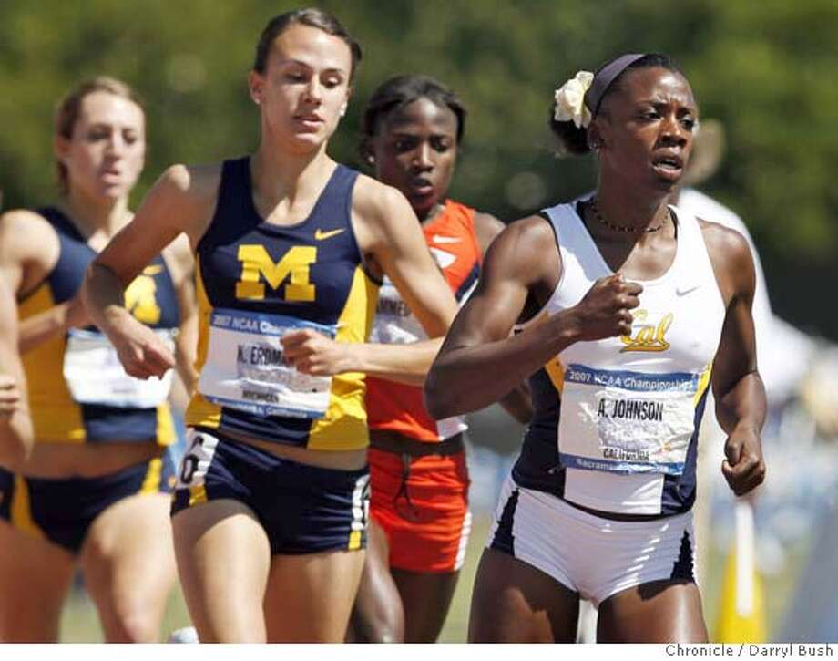 ncaatrack_0008_db.JPG  Alysia Johnson of California, right, leads Katie Erdman of Michigan, on the first lap, as she goes on to win the Women 800 Meter Run at the NCAA Division 1 2007 Outdoor Track & Filed Championship at California State University Sacramento, Hornet Stadium in Sacramento, CA, on Saturday, June, 9, 2007. photo taken: 6/9/07  Darryl Bush / The Chronicle ** roster (cq) Photo: Darryl Bush