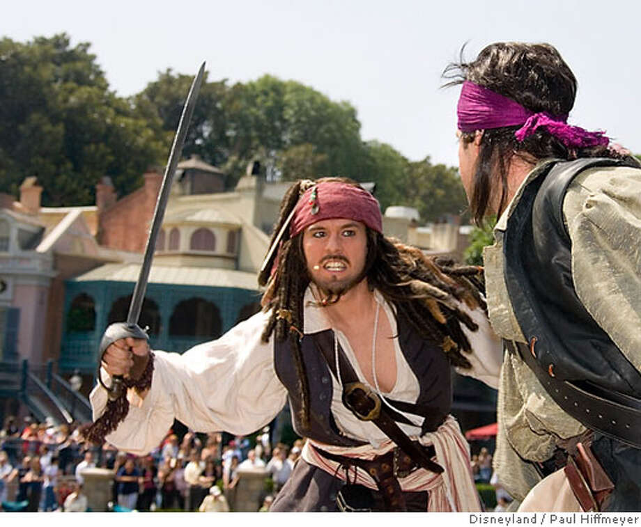 """In this photo released by Disneyland, actors perform in the all-new interactive """"Pirate's Lair on Tom Sawyer Island"""" at Disneyland in Anaheim, Calif., Friday, May 25, 2007. The attraction opened Friday. (AP Photo/Disneyland, Paul Hiffmeyer) ** NO SALES** Photo: Paul Hiffmeyer"""
