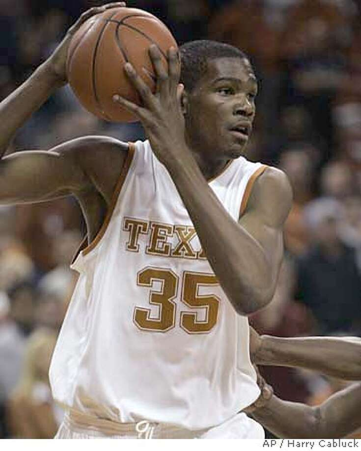 Texas freshman forward Kevin Durant looks to pass after grabbing a defensive rebound during the first half of a basketball game against Texas-Arlington on Tuesday, Jan. 2, 2007, in Austin, Texas. Texas opens the Big 12 season in Colorado on Saturday. For Texas and its crew of talented freshmen, the first two months of the season were a fun, sometimes frustrating, always exciting, introduction to the season. (AP Photo/Harry Cabluck)  Ran on: 01-17-2007  Freshman Kevin Durant has averaged 34 points and 13.5 rebounds in the Longhorns' four Big 12 games.  Ran on: 01-17-2007 EFE OUT Photo: Harry Cabluck