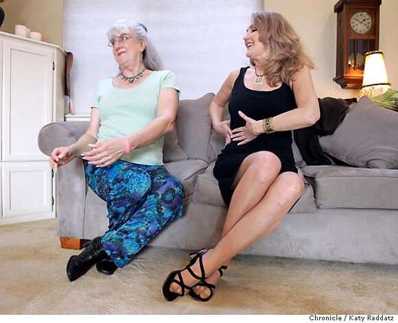"SHOWN: Denae Doyle (wearing black) coaches her client Rosalea Roberts on the fine points of crossing one's legs like a lady and maintaining feminine posture while seated on a couch. Denae Doyle is a coach/stylist for transgender women. She is shown working with her client Rosalea G. Roberts at Doyle's home/office in Santa Cruz. Doyle coached Felicity Huffman to prepare for her role in ""Transamerica."" Photo taken on 12/11/05, in Santa Cruz, CA.  By Katy Raddatz / The San Francisco Chronicle Photo: Katy Raddatz"