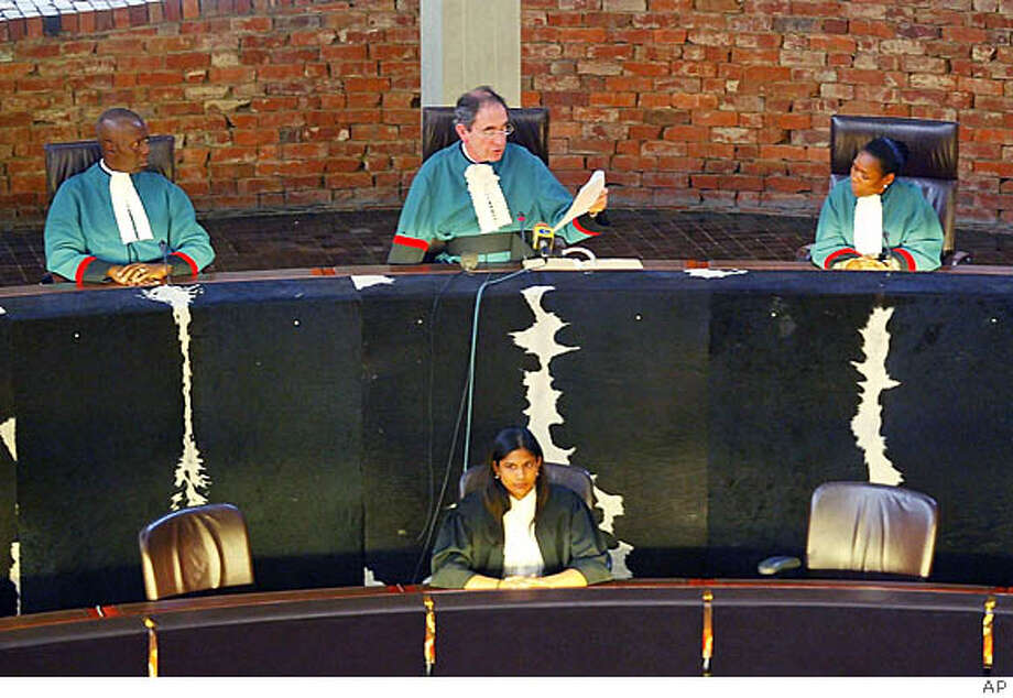 Constitutional Court judge, Albie Sachs, center back, delivers a ruling in Johannesburg, Thursday, Dec. 1, 2005, that it is unconstitutional to prevent gay people from marrying. The ruling paves the way for the country to become the first to legalize same-sex unions on a continent where homosexuality remains largely taboo. (AP Photo/str) **SOUTH AFRICA OUT** Photo: AP