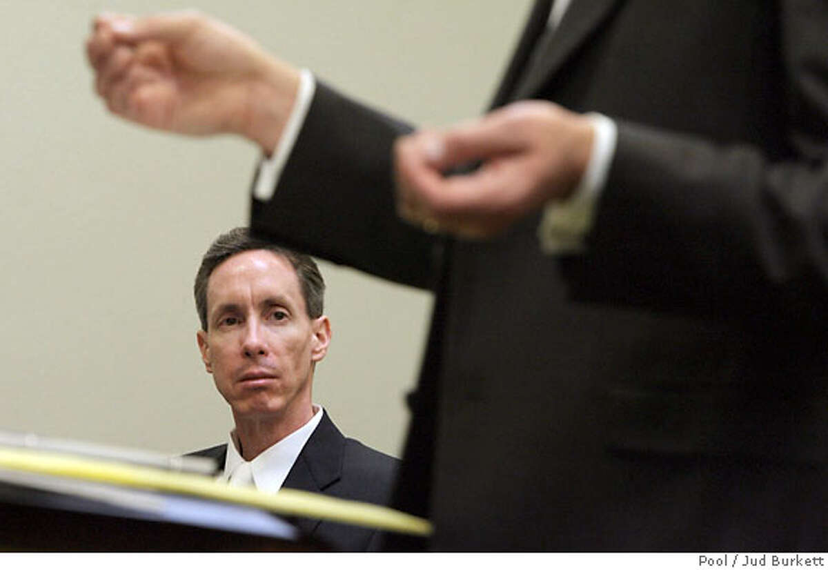 Warren Jeffs, left, president of the Fundamentalist Church of Jesus Christ of Latter Day Saints, listens as Jeff Hunt, right, an attorney for the media, presents arguments for the release of sealed court documents, Friday, May 25, 2007, during a hearing before Fifth District Judge James Shumate in St. George, Utah. Jeffs, the self-proclaimed prophet of a polygamous sect, is charged with two counts of rape as an accomplice for his role in the 2001 marriage of the underage girl to her 19-year-old cousin. (AP Photo/Jud Burkett, Pool) POOL PHOTO