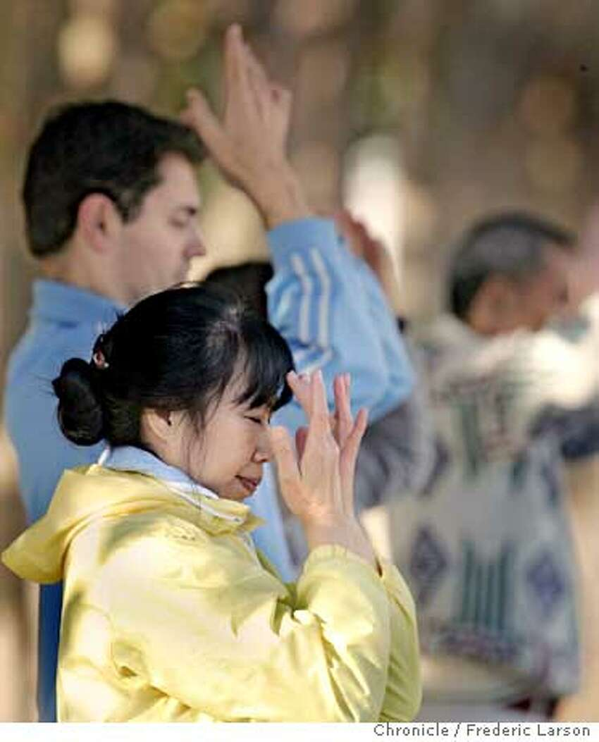 ANTIFALUN_SF109_fl.jpg Amy Wu (foreground) and Ivan Velinov are Falun Gong practioners (at SF City Hall Plaza) who meet up each morning around San Francisco and the Bay Area to meditate and practices graceful, slow moving exercises. 11/9/05 San Francisco CA Frederic Larson San Francisco Chronicle