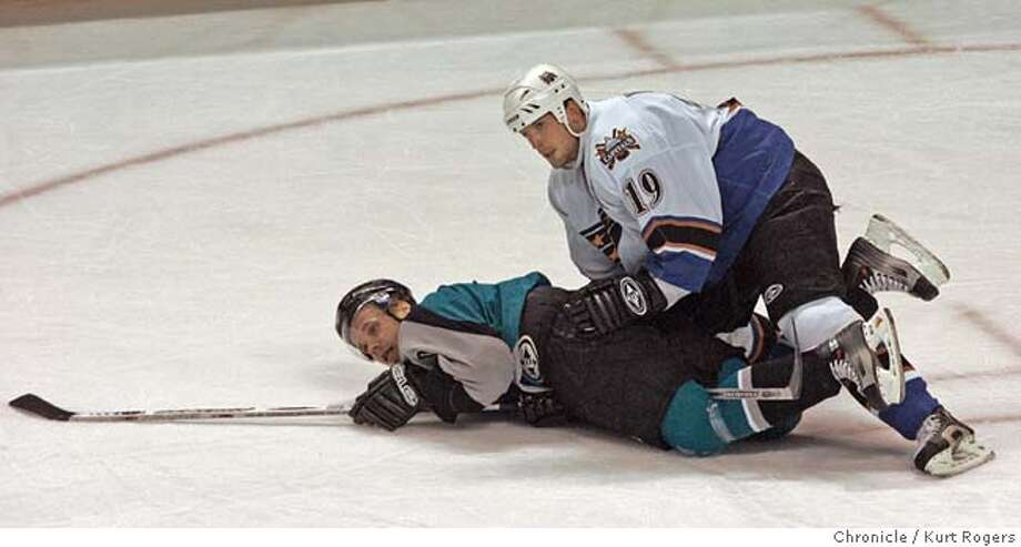 Washington's Brendan Witt slams Milan Michalek to the ice in the first period.  The San Jose Sharks vs the Washington Capitals.  Kurt Rogers SAN JOSE SFC  The Chronicle Photo: Kurt Rogers