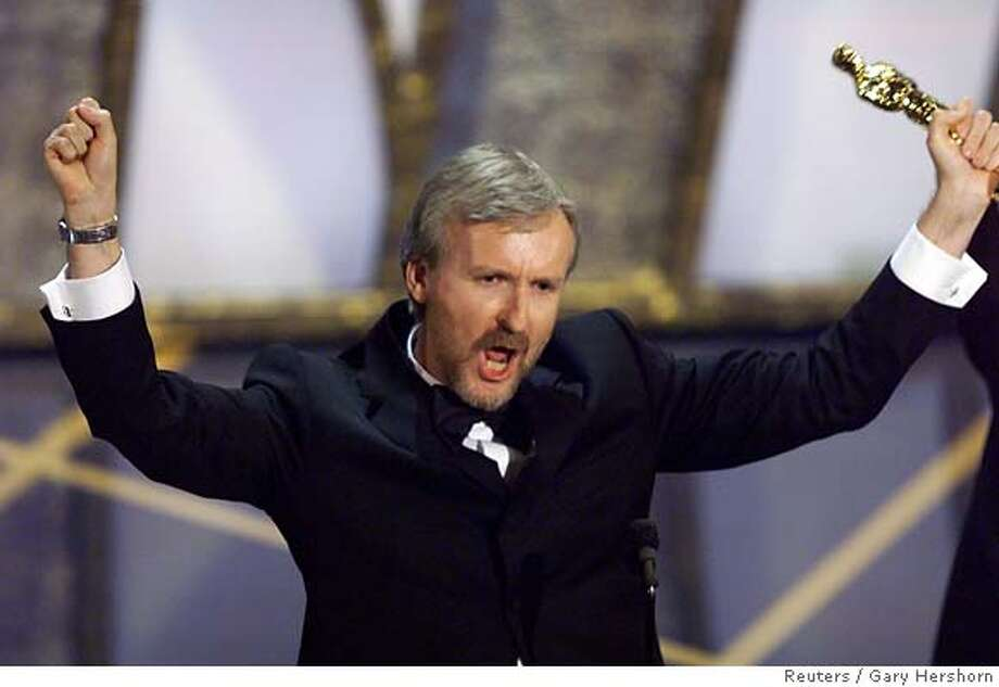 "James Cameron holds up the Oscar he won for best director for the movie ""Titanic"" in 1998. He is selling 730 acres in Malibu. Reuters photo by Gary Hershorn"