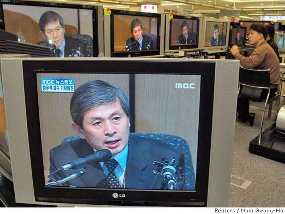 South Koreans watch stem cell scientist Hwang Woo-suk's news conference on TV at a shop in Seoul December 16, 2005. A South Korean scientist whose work is under intense scrutiny hit back at his accusers on Friday, saying he had proof his team had made patient-tailored stem cells this year and he would produce the evidence soon. KOREA OUT NO ARCHIVE NO RESALE REUTERS/Nam Gwang-Ho/Newsis 0 Photo: NEWSIS